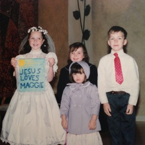 That's me in the purple. Probably upset because they sang the Our Father at my sister's communion. Or because my mom dressed me like Laura Ingalls Wilder from Little House on the Prairie.